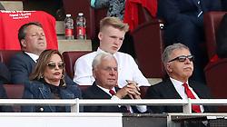 Arsenal's majority shareholder Stan Kroenke (right) in the stands