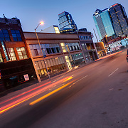 Traffic motion at dusk on Grand Avenue in downtown Kansas City, Missouri.