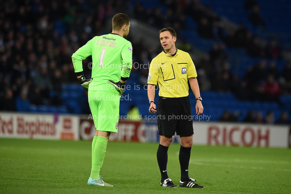Referee Stuart Attwell has words with Cardiff city goalkeeper David Marshall.Skybet football league championship match, Cardiff city v Watford at the Cardiff city stadium in Cardiff, South Wales on Sunday 28th December 2014<br /> pic by Andrew Orchard, Andrew Orchard sports photography.