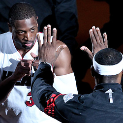 Jun 21, 2012; Miami, FL, USA; Miami Heat shooting guard Dwyane Wade (3) and small forward LeBron James (6) prior to tip off of game five in the 2012 NBA Finals at the American Airlines Arena. Mandatory Credit: Derick E. Hingle-US PRESSWIRE