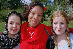 Multiracial group of girls standing together smiling,