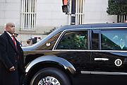 President Barack Obama waves from the car during the inauguration parade on January 21, 2013 in Washington, D.C.