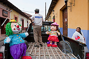 27 APRIL 2005 - SAN CRISTOBAL DE LAS CASAS, CHIAPAS, MEXICO: A woman walks past a truck hauling piñatas to a houe in San Cristobal de las Casas, Chiapas, Mexico. San Cristobal de las Casas is an important tourist destination for those who want to visit Mexican colonial cities. San Cristobal is the center of the Chiapas highlands and an important indigenous community. Fear of political violence in the area has diminished in recent years and the tourism industry has rebounded as a result.  PHOTO BY JACK KURTZ