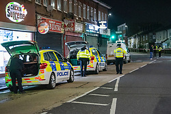 © Licensed to London News Pictures. 05/02/2020. London, UK. Officers gather equipment from vehicles after the Metropolitan Police Service was called to Kingsley Rd in Hounslow at 19:23GMT on Tuesday 4th Feb to reports of a fight. A 19-year-old man then self-presented at a hospital with stab injuries. One person has been arrested. Photo credit: Peter Manning/LNP