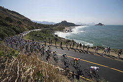 August 6, 2016 - Rio de Janeiro, RJ, Brazil - The main pack of cyclists pass along the coast during men's road cycling at the Rio 2016 summer Olympic games. (Credit Image: © Christopher Morris via ZUMA Wire)