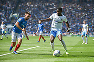 Portsmouth Midfielder, Ben Close (33) and Coventry City Forward, Bright Enobakhare (24) challenge for the ball during the EFL Sky Bet League 1 match between Portsmouth and Coventry City at Fratton Park, Portsmouth, England on 22 April 2019.