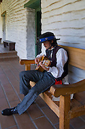 Park docent in costume playing guitar, Casa de Estudillo Museum, Old Town San Diego State Historic Park, San Diego, California