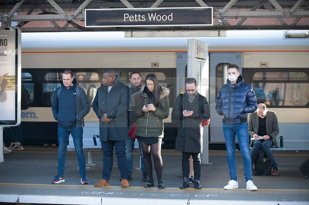 ©Licensed to London News Pictures 13/03/2020<br /> Pettswood, UK. Commuters standing apart on a half empty train platform. London commuters at Pettswood train station this morning in Pettswood, Kent are keeping their distance from each other by standing a meter apart as the Coronavirus threat continues in the UK. Commuter numbers are down as many work from home.  Photo credit: Grant Falvey/LNP