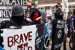 London, November 19th 2014. Thousands of students march through central London, demanding that education fees are scrapped by the government. PICTURED: Masked anarchists pose for pictures.
