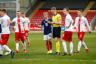 Scotland's Connor Barron (Aberdeen) receives a caution for his challenge on Nicola Zalewski during the U17 European Championships match between Scotland and Poland at Firhill Stadium, Maryhill, Scotland on 26 March 2019.