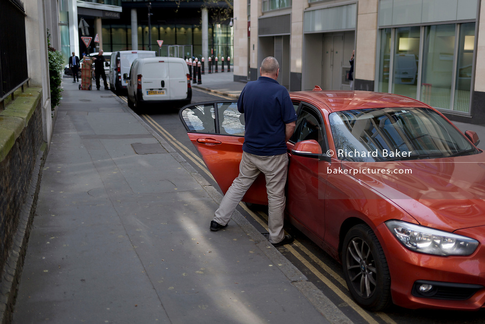 A man makes a quick toilet stop in a quiet side street in the City, a quick pee in the Square Mile, on 3rd March 2017, in the City of London, England.
