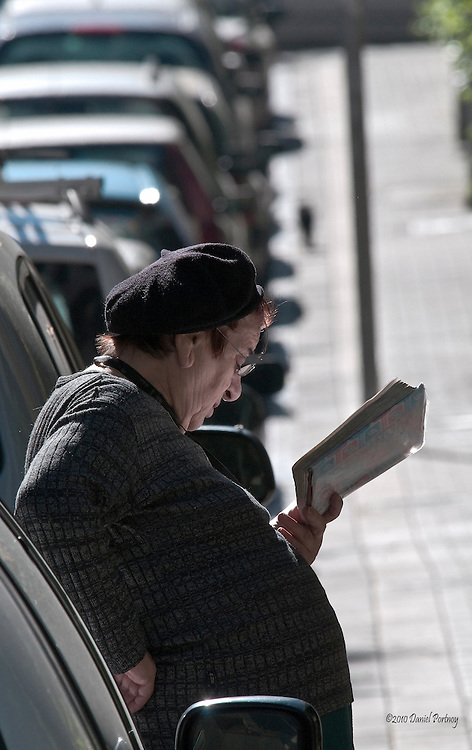 Leaning on car reading book in Tel-Aviv Israel