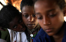Alemenesh Bere, 11, is comforted by the sisters of her new husband Manale Bihone, 23, in the Yeterater Miriam village outside of Bahir Dar, Amhara Region, Ethiopia on May 26, 2007.  Because many married adolescents are pulled out of school at an early age, they may be unfamiliar with basic reproductive health issues, including the risk of HIV. Married adolescents often face familial and societal expectations to have children as soon as they are married. Even if contraceptive services are available, married adolescent girls may lack the power to use them, aggravating the risks of maternal mortality and morbidity for pregnant adolescents.