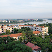 Modern buildings in Hue, Vietnam, with the Perfume River in the background.