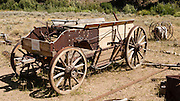 Old fire wagon. Formerly a gold mining town from 1879-1910, Custer Historic Site is now a ghost town, near Stanley, Idaho, USA. The city of Custer was named after General George Armstrong Custer, who was killed in battle in 1876. Custer is now part of the Land of the Yankee Fork State Park and Challis National Forest Historic Area.