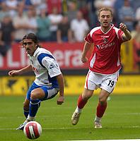 Photo: Daniel Hambury.<br />Charlton Athletic v Portsmouth. The Barclays Premiership. 16/09/2006.<br />Charlton's Dennis Rommedahl and Portsmouth's Pedro Mendes battle.