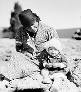 9305-B7347. Indian woman and child at Celilo Falls