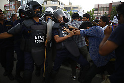 August 15, 2017 - Kathmandu, Nepal - An activist pushes a police personnel during a demonstration to save the life of Dr. Govinda KC who is in hunger strike for the last 23 days for the 11th time demanding reforms in medical education sector in Kathmandu, Nepal on Tuesday, August 15, 2017. (Credit Image: © Skanda Gautam via ZUMA Wire)