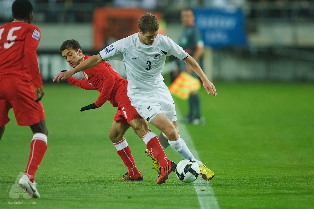 All White defender Tony Lockhead and Mohamed Ahmed Holbail fight for the ball during the second leg of the 2010 FIFA World Cup qualifying game in front a record 35,194 football fans at Westpac Stadium on November 14, 2009. New Zealand beat Bahrain 1-0 and secured a spot at the 2010 World Cup in South Africa.