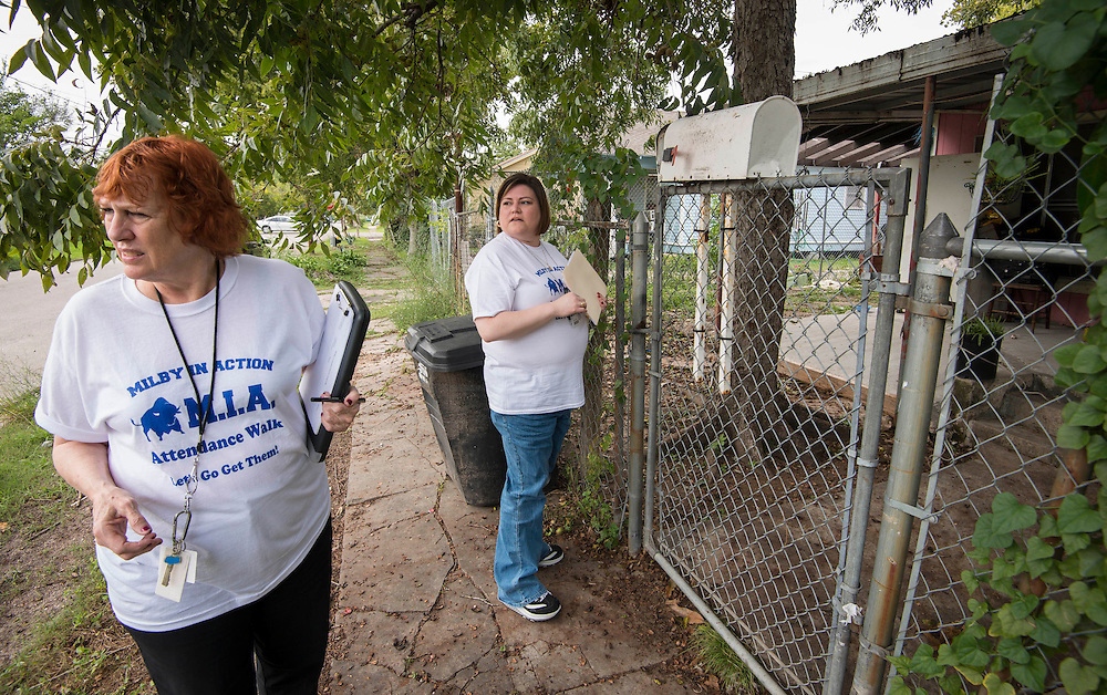 """Mary Smith and Heidi Cisneros participate in the """"Milby in Action"""" home visit initiative to reach students with excessive absences or failing grades at Milby High School, October 14, 2013."""