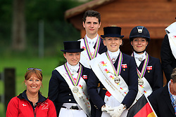 Podium Young Riders team Denmark<br /> 2. DEN : Kragekjaer Andreas, Lindberg Rikke, Merrald Nanna Skodborg, Dufour Cathrine, chef d'equipe Holtze Isabella<br /> FEI European Dressage Championship Juniors - Young Riders - Bern 2012 <br /> © Hippo Foto - Leanjo de Koster