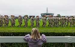 © Licensed to London News Pictures. 10/07/2012..Harrogate, England...A young girl watches as soldiers from the 1st Battalion The Yorkshire Regiment exercise the Freedom of Harrogate with a march past at the Great Yorkshire Show after recently returning from Afghanistan...England's premier agricultural show opened it's gates today for the start of three days of showcasing the best in British farming and the countryside...The event, which attracts over 130,000 visitors each year is the 154th show and displays the cream of the country's livestock and offers numerous displays and events and gives the chance to see many different countryside activities...Photo credit : Ian Forsyth/LNP