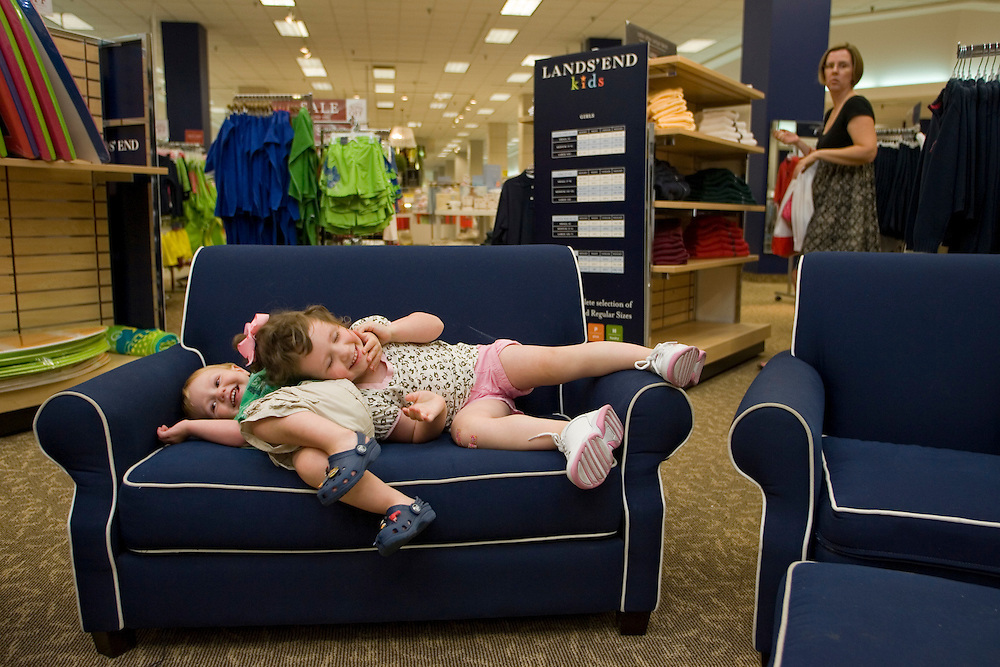 Fiona Reenan, 3 1/2, of Naperville, Illinois, plays on childrens' furniture with her brother Trevor 1 1/2, at the Lands' End store inside the Sears store at Oakbrook Center in Oakbrook, Ilinois.