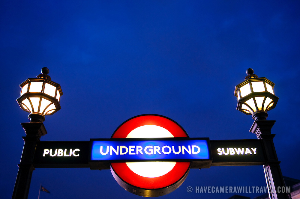 London Underground entrance and sign at Piccadilly Circus, at night, with a rich, deep blue sky in the background with copyspace. Editorial use only.