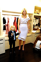PRINCESS MARIE-CHANTAL OF GREECE and her son PRINCE ODYSSEAS-KIMON at a party to celebrate the opening of her store 'Marie-Chantal' 133A Sloane Street, London on 14th October 2008.