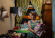 Italy, Capannori, Martina, she never buy new clothing, she receive a huge amount of second hand clothing , she keeps what she needs and give away waht she doesn't