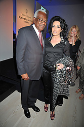 SIR TREVOR MACDONALD and NANCY DELL'OLIO at the presentation of the Veuve Clicquot Business Woman Award 2009 hosted by Graham Boyes MD Moet Hennessy UK and presented by Sir Trevor Macdonald at The Saatchi Gallery, Duke of York's Square, Kings Road, London SW1 on 28th April 2009.