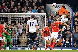 Tottenham's Michael Dawson heads the ball - Photo mandatory by-line: Mitchell Gunn/JMP - Tel: Mobile: 07966 386802 02/03/2014 - SPORT - FOOTBALL - White Hart Lane - London - Tottenham Hotspur v Cardiff City - Premier League