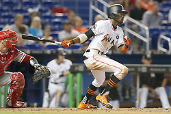 May 31, 2017 - Miami, FL, USA - The Miami Marlins' Dee Gordon hits an RBI single in the fifth inning against the Philadelphia Phillies on Wednesday, May 31, 2017 at Marlins Park in Little Havana in Miami. The Marlins won, 10-2. (Credit Image: © Pedro Portal/TNS via ZUMA Wire)