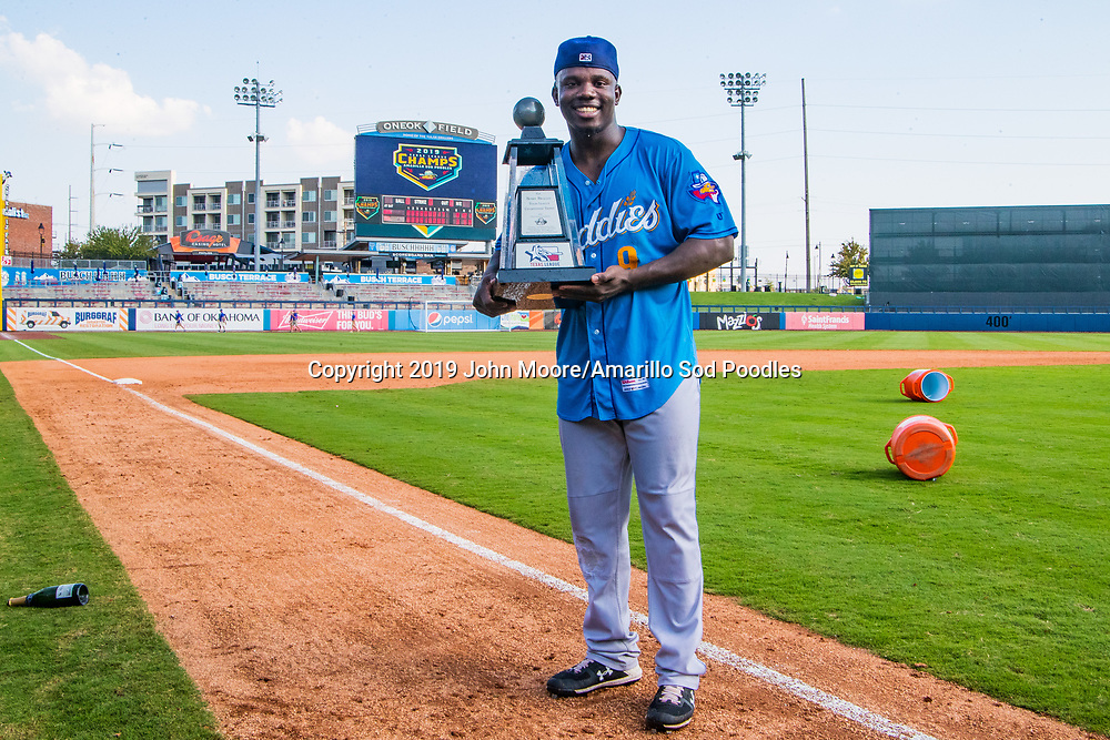 Amarillo Sod Poodles infielder Ruddy Giron (9) poses with the trophy after the Sod Poodles won against the Tulsa Drillers during the Texas League Championship on Sunday, Sept. 15, 2019, at OneOK Field in Tulsa, Oklahoma. [Photo by John Moore/Amarillo Sod Poodles]