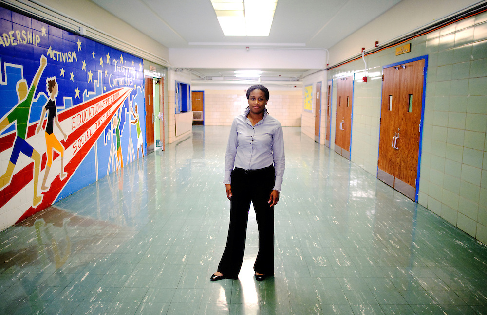 (photo by Matt Roth).Friday, May 14, 2010..Principal Khalilah Harris stands in the front hallway of her school, the Baltimore Freedom Academy, a grade 6-12 Baltimore public charter school focusing in social justice. The building was built in 1960. Fifty years later, the school is in disrepair. Old pipes make water from the fountains undrinkable. Asbestos makes repairing/replacing the pipes a hazard. The school has no air conditioning which makes the year-round school unbearable in the summer. The most derelict area is the boys locker room, where students are not allowed.