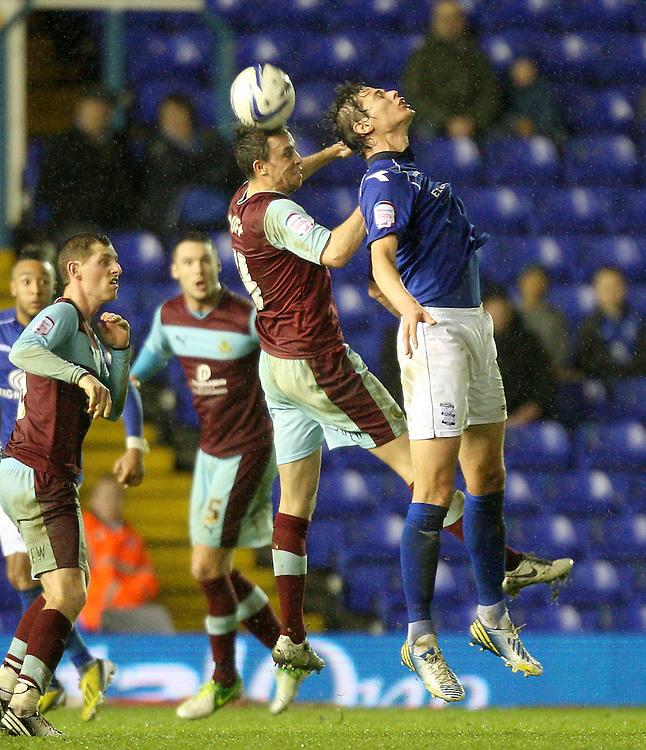 Burnley's Michael Duff battles with Birmingham City's Nikola Zigic ..Football - npower Football League Championship - Birmingham City v Burnley - Saturday 22nd December 2012 - St Andrews - Birmingham..
