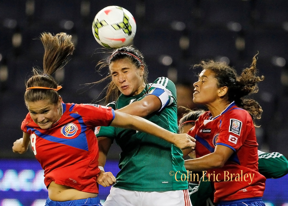 Costa Rica's Fabiola Sanchez, left, and Raquel Rodriguez Cedeno, right, battle Mexico's Lydia Nayeli Rangel, center, for a header during the second half of a CONCACAF Women's Championship soccer match, Thursday, Oct. 16, 2014, in Kansas City, Kan. (AP Photo/Colin E. Braley)