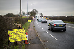 © Licensed to London News Pictures . 10/03/2017 . Preston , UK . Anti fracking signs posted along the roadside opposite Plumpton Hall Farm . Farmer Allan Wendlsy faces protests from neighbours and environmental campaigners after renting fields around his farm , Plumpton Hall Farm , to fracking firm Cuadrilla . Photo credit : Joel Goodman/LNP