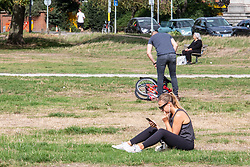 "© Licensed to London News Pictures. 12/09/2020. London, UK. Walkers and sunbathers enjoy the glorious sunshine on Wimbledon Common in South West London this afternoon before the ""Rule of 6"" comes into force on Monday as weather experts announce a 6 day mini heatwave in the South East of England this week with highs in excess of 29c. Prime Minister Boris Johnson is already under pressure after he announced on Friday that gatherings of more than six people will be banned from Monday in the hope of reducing the coronavirus R number. The Rule of Six as it is known, has already become unpopular with MPs and large families. Photo credit: Alex Lentati/LNP"