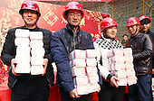 Migrant Workers Receive 1.75 million USD Cash At Construction Site