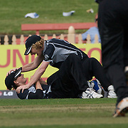 New Zealand fielder Nicola Browne is congratulated by Captain Haidee Tiffen after catching Australian batsperson Jessica Cameron on the boundary during the Australia V New Zealand group A match at North Sydney Oval in the ICC Women's World Cup Cricket Tournament, in Sydney, Australia on March 8, 2009. New Zealand beat Australia by 13 runs in the (D/L method)  rain affected match. Photo Tim Clayton