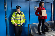 As environmental activists protest about Climate Change, police officers secure the outside the terminal building during the occupation of City Airport (London's Business Travel hub) in east London, the fourth day of a two-week prolonged worldwide protest by members of Extinction Rebellion, on 10th October 2019, in London, England.