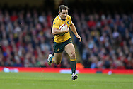Bernard Foley of Australia runs in and heads for the try line to score his try. Under Armour 2016 series international rugby, Wales v Australia at the Principality Stadium in Cardiff , South Wales on Saturday 5th November 2016. pic by Andrew Orchard, Andrew Orchard sports photography