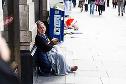 A woman begs on Oxford Street at Marble Arch. Over the last few years London has seen increasing numbers of Eastern European beggars and street performers on its streets as they flock to the UK and other wealthier countries to take advantage of people's generosity. London, August 02 2019.