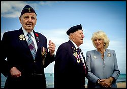 Image ©Licensed to i-Images Picture Agency. The Duchess of Cornwall talks to veterans l to r Lloyd Bentley 93, Stanley Clark Fields 95, on Juno Beach, Normandy, France, on the eve of the 70th anniversary of D-Day, Thursday, 5th June 2014 Picture by Andrew Parsons  / i-Images