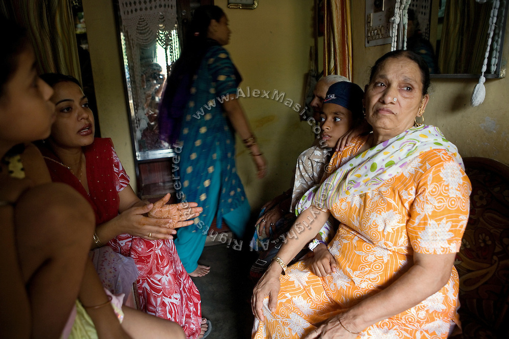 Harjinder Kaur, 57, (right) and Nirmal Kaur, 32, (second from left) are portrayed in Harjinder's home in Tilak Vihar, New Delhi, India. They have lost their husbands and other members of their family during the anti-Sikh riots erupted in New Delhi in 1984 in the light of Indira Gandhi's assassination by her Sikh bodyguards.