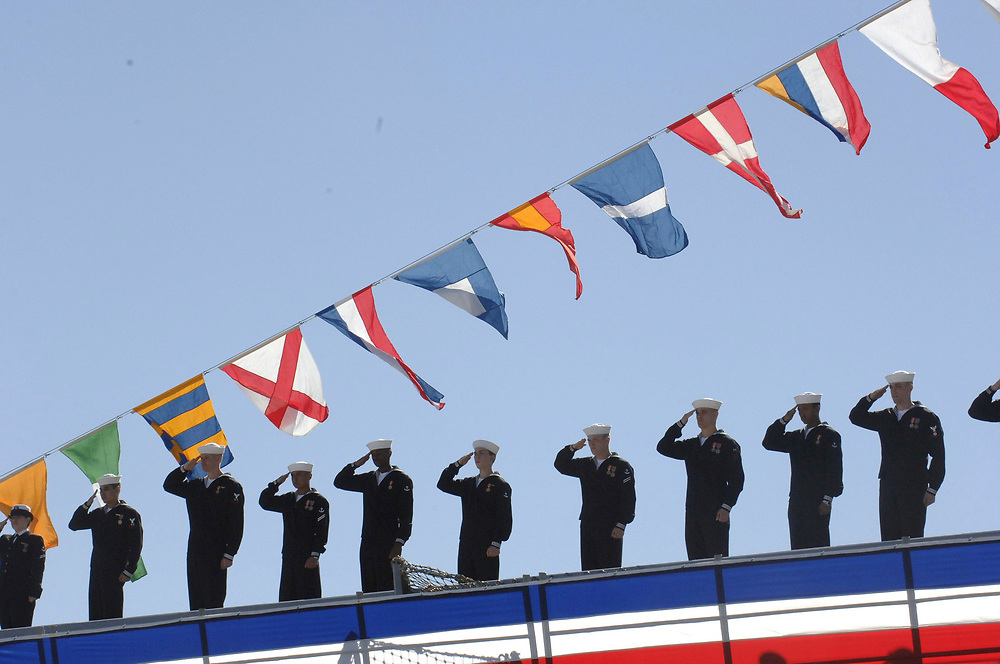 Ingleside, Texas January 14, 2006: Sailors salute at the commissioning of the USS San Antonio (LPD-17) Amphibious Transport Dock, the newest San Antonio-class transport ship with state-of-the-art warfare capabilities. ©Bob Daemmrich /