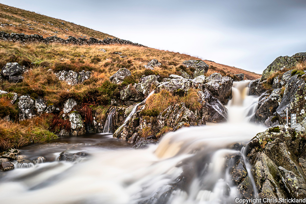 Talla, Tweedsmuir, Scottish Borders, UK. 12th November 2019. The waterfalls of Talla Water in full flow as snow melt and heavy rain runs off the Southern Uplands into Talla Reservoir in the Scottish Borders.