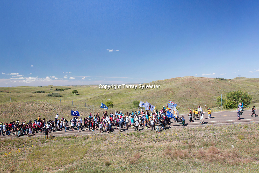 Opponents of the Dakota Access oil pipeline march to the pipeline route near the Standing Rock Sioux Reservation on August 27, 2016. Cannon Ball, North Dakota, United States.