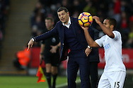 Slaven Bilic, the West Ham Utd manager (c) looks on from the touchline. Premier league match, Swansea city v West Ham United at the Liberty Stadium in Swansea, South Wales on Boxing Day, Monday 26th December 2016.<br /> pic by  Andrew Orchard, Andrew Orchard sports photography.